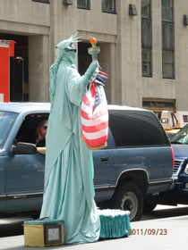 Street artist - Statue of Liberty - 5th Avenue, New York, September 2011